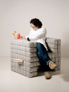 """Lost in Sofa"" sofa is a very creative design by Daisuke Motogi. ""Lost in Sofa"" is a very up-to-the-minute sofa composed of several soft, square-based cube- or rectangular-shaped units.  ""Anything can be inserted anywhere"""
