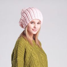 A beanie featuring knitted fabric with top pom pom design ed674bdc3896