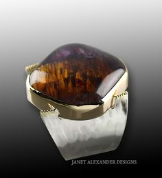 Cacoxenite in Amethyst mounted in Argentium Silver with 24k gold granulation accents, by Janet Alexander