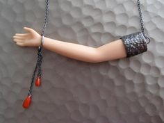 This reminds me of necklaces in a shop by Manzan's house........... Really cool!
