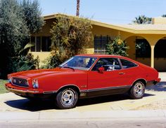 1974 Ford Mustang II Mach 1 hatchback coupe. Say what you will. I had a 74 Fastback in Bullitt Green, and liked it!