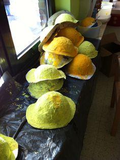 Helmen papier marché