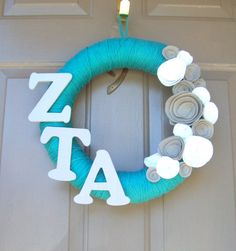 Zeta Tau Alpha Yarn Wreath  Or this one...  @Kimberly Chapman $23