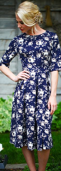 """Textured navy floral dress with half sleeves and a pretty pleated bottom. Looks great accessorized with a belt! Comfortable and classy modest dress. Total Length: XS-S 41.5"""" M-L 42"""" XL 42.5"""""""