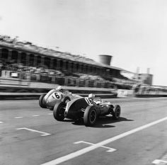 Bruce McLaren and Stirling Moss take the final furlong in this epic pic from Aintree '59. Happy Birthday, Sir Stirling.