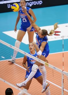 Valentina Arrighetti #13 of Italy spikes the ball as Dae-Young Jung #13 of Korea defends during Women's Volleyball quarterfinals on Day 11 of the London 2012 Olympic Games at Earls Court on August 7, 2012 in London, England.