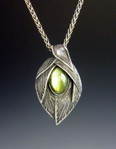 I called this piece Waiting for Spring.  It is a bright green Labradorite, bezel set in fine silver.  I wanted to make it look like a bud, just about to unfold and the stone is the life within, waiting for spring.--Lisa Barth