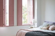 Pink solid-panel shutters give this pretty bedroom design a restful feel.theshuttersto… - ALL ABOUT Bedroom Window Design, Bedroom Shutters, Interior Window Shutters, Interior Windows, Bedroom Windows, Home Interior, Interior Decorating, Bedroom Decor, Window Shutters Inside