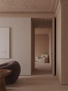 Le dernier projet de l'architecte d'intérieur Kanstantsin Remez basé à Minsk, nommé Ratomska, est un appartement en forme de L qui présente une palette monotone de bois, beige et couleurs claires associée à des meubles sculpturaux. Le design intérieur combine des lignes droites austères et des objets en calcaire, avec le sol, les murs et le plafond habillés d'un bois chaleureux. L'appartement suit une forme en L, avec une cuisine et un salon, un balcon avec un petit coin repas et une… Bathroom Lighting, Oversized Mirror, Interior Design, Architecture, Modern, Furniture, Home Decor, Behance, Photography