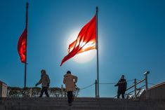 The red communist China flag flies, above Tiananmen Square, from the ramparts of the Forbidden City in Beijing, China.