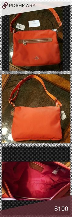 """NWT COACH SAWYER PURSE NWT COACH SAWYER PURSE.  ORANGE NYLON WITH GOLD   HARDWARE.  SHOULDER STRAP EXTENDS TO CROSSBODY STRAP. 10.5"""" (L) x 9"""" (H) x 5"""" (D). TOP ZIP CLOSURE WITH FRONT ZIPPERED POCKET.   SAME OR NEXT DAY SHIPPING. Coach Bags Crossbody Bags"""