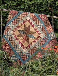 Martingale - Civil War Remembered - Like a star medallion. Must remember to do multiple pieced borders around it.