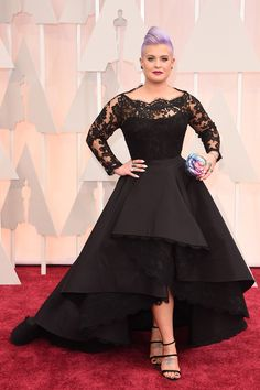 Kelly Osbourne in a vintage black lace and satin mother of the bride/groom dress at Oscars 2015 red carpet. Kelly Osbourne Oscars 2015 dress featuring asymmetric high low celebrity mothe of the bride/groom gown, lace bodice with sheer long sleeves. High Low Prom Dresses, Plus Size Formal Dresses, Prom Dresses Long With Sleeves, Black Prom Dresses, Black Evening Dresses, Lace Dress Black, Sheer Dress, Nice Dresses, Evening Gowns