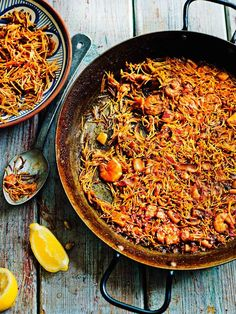 Fideuà, a version of paella which uses fideos pasta, brings together squid, prawns, tomatoes and sweet but spicy pimentón. Serve with a dollop of garlic alioli. Tapas Recipes, Seafood Recipes, Pasta Recipes, Cooking Recipes, Tapas Ideas, Dinner Ideas, Dinner Recipes, Food Ideas, Meals