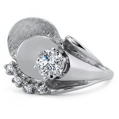 The Giverny Ring from Brilliant Earth. .....this is such an interesting design I had to pin it