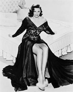 Jane Russell in a plunging black evening gown.