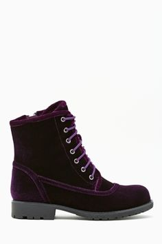 Shoe Cult Converge Combat Boot - Purple Velvet $110.00 Shoe Cult by Nasty Gal is our very first footwear collection! Snap 'em up - these are styles you won't find anywhere else. Super cute purple velvet combat boots featuring a lace-up front with stitch detailing and treaded sole. Side zip closure, lined interior.