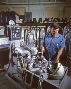A Project Mercury astronaut looks over his spacesuit. Take A Look Inside NASA In The Cosmos, Project Mercury, Nasa Space Program, Nasa Photos, Nasa Astronauts, Nasa Planets, Apollo Missions, Space Projects, Space Race