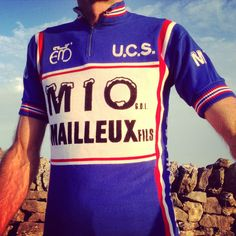 Our vintage cycle jerseys are carefully sourced 'newold stock'.They are unique one-off pieces. Key features: Made in Belgium Flock lettering 3 rear pockets short sleeve blue / white band / red,white and blue stripes neck and sleeves half zip 100% acrylic machine washable. Available at glorydays.cc