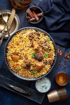 Mutton Biryani is a royal dish of beautifully spiced and fragrant layers of biryani rice centred with juicy, tender mutton and masalas, bliss! It holds a regal legacy from the kitchen of Nawabs and Nizams. Serve it with your favourite raita or salad or enjoy it as is. Veg Recipes, Kitchen Recipes, Indian Food Recipes, Cooking Recipes, Healthy Recipes, Dinner Recipes, Pakistani Food Recipes, Arabic Recipes, Cooking Tips