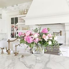 White kitchen with marble countertops and backsplash - Rach Parcell