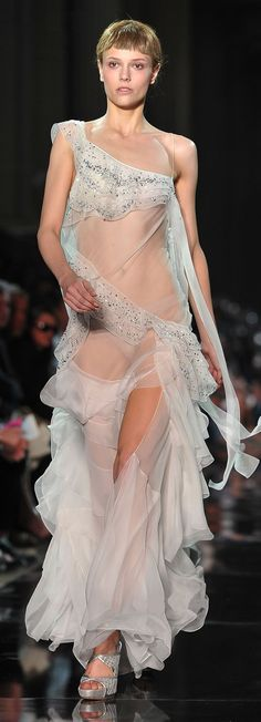 A model walks the runway during the John Galliano Ready to Wear Spring / Summer 2012 show during Paris Fashion Week on October 2011 in Paris, France. Couture Fashion, Runway Fashion, Paris Fashion, Fashion Trends, High Fashion Dresses, Transparent Dress, Fashion Group, John Galliano, Beautiful Gowns