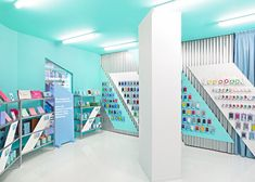 Spanish design studio Masquespacio chose hospital colours for the exterior, interior and branding of this smartphone and tablet repair shop in Valencia.