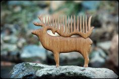 Wooden hair comb Deer by WonderfulSun on Etsy --- do out of antler