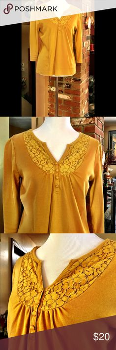 St. John's Bay Cotton Blouse Soft 100% cotton top has a lacy smocked pattern that starts at each shoulder and down the length of the v-neck. Four decorative cloth buttons enhance this detail. An extra button is still attached to the tag on inside of blouse. St. John's Bay Tops Blouses