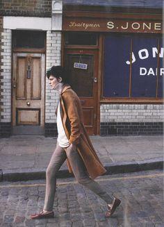 Tan coat and slim trousers