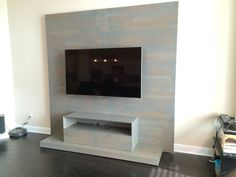 Paneled white oak entertainment center handcrafted and finished with a grey washcoat by Austin Joinery Custom Furniture