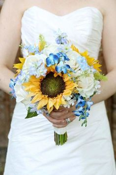 Blue, white and yellow wedding bouquet with sunflowers and roses