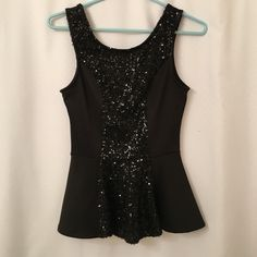 Black sequin peplum top Good condition. Sequins in front and zipper in the back Charlotte Russe Tops