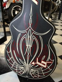 Sweet stripes on this guitar case by, F.K. A2C via pinhead lounge.