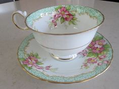 Pretty floral tea cup and saucer, Delphine China, Orchard pattern. Made in England. Selling at this price because there are two faint hairline cracks in the teacup, the saucer is in great condition. Still so beautiful. Tea cup measures 2 1/4 tall by 3 3/4 diameter. Saucer measures 5