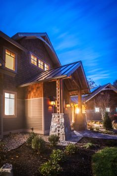 Completed custom home at dusk, entry way with natural stone and timbers. Louden Ridge, Saratoga Springs, NY