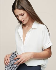 White shirt with navy trousers and python clutch | Reiss