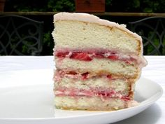 "Strawberry Cake made with fresh strawberries, strawberry jam, and strawberry cream cheese frosting. White cake layers are made using ""Elegant White Cake"" recipe by @King Arthur Flour"