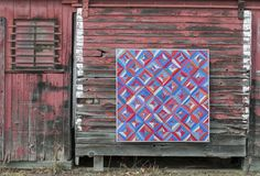 Blue and red barn