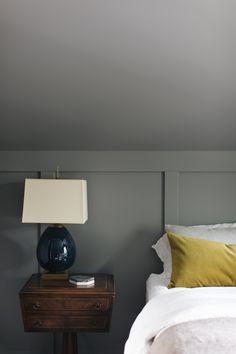 Bedroom, wood paneling, bedroom lamp, antique furniture, linen bedding, velvet, velvet pillow, bedroom design, bedroom decor, bedroom decorating.