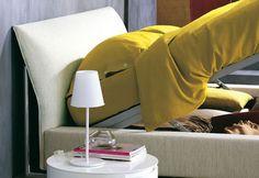 """An elegant double-size bed that evokes the shape of a sailboat // Elegante letto matrimoniale che evoca le forme di una barca a vela [Double Bed / Letto matrimoniale """"Sailor"""" by Flou] #Beds #Bedroom #Letto #InteriorDesign #HomeDecor #Design #Arredamento #Furnishings #yellow"""