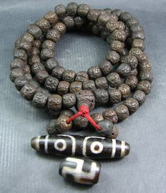 Currently at the #Catawiki auctions: A Rudraksha Mala and 2 Dzi beads - Himalayan regions - second half of the 20t...