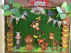 classroom display - Welcome to the jungle. Our amazing jungle display, including an area to sit and discuss the topic.