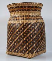 Rivercane Basket Eva Wolfe: Wolfe wove rivercane baskets using both the single weave and double weave techniques. She won many awards at the annual Cherokee Fair. I