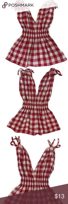 "Torrid Red/White Gingham V-neck & Back Peplum Top Sleeveless v-neck and back peplum summer top. Adjustable shoulder ties. Approx. length 24"", armpit to armpit 14 1/2"". Elastic waistband. Torrid Tops Tank Tops"