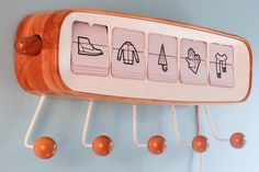 """A smart clothes hanger called Take Off has been on the line recently, and its classical appearance and interesting usage are refreshing. It uses wooden fuselage and displays 5, auto flip cards as """"screens"""" to display time, temperature and clothing information.   #smartclotheshanger"""