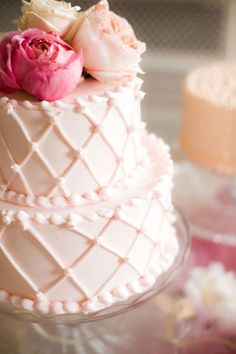 blush pink icing with flower topper cake