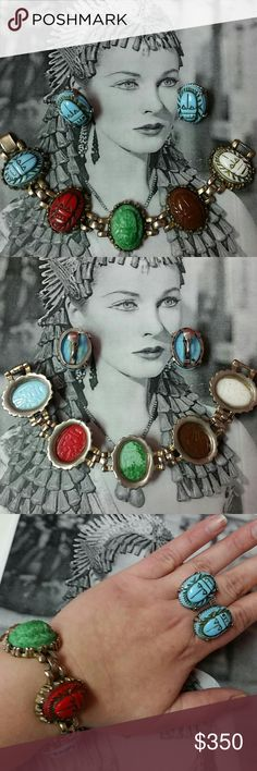 """Vintage 30's Czech Glass Egyptian Scarab set Vintage 1930's Egyptian Revival multicolored Czech glass Cabochon Scarab Bracelet and earring set. Gold wash is worn in places but overall in excellent vintage condition due to age. Earrings are Robin's egg blue screwbacks. Bracelet colors are Red, Robin's egg blue, white, green, and brown. Clasp is firm. Scarab are about 1"""" long and .75"""" wide. Hieroglyphics on underside of each scarab. Bracelet is about 7.5"""" long. Possibly Max Neiger design…"""