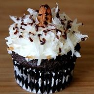 Almond Joy Cupcakes: Chocolate cupcakes with creamy, gooey coconut filg, coconut frosting and an almond