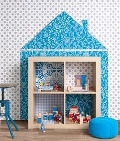 dollhouse on wall with bookcase for rooms...super clever